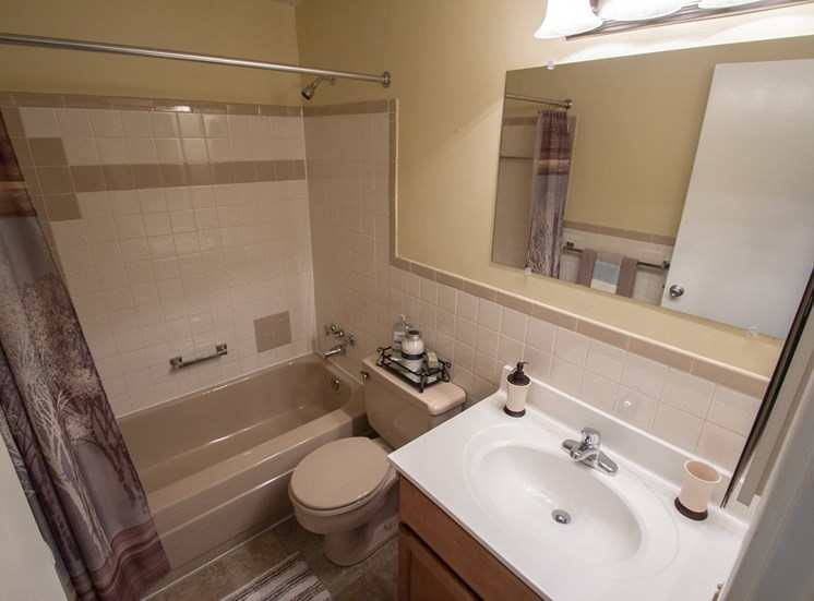 This is picture of the full bathroom in an 823 square foot 2 bedroom apartment at Aspen Village Apartments in Cincinnati, OH.