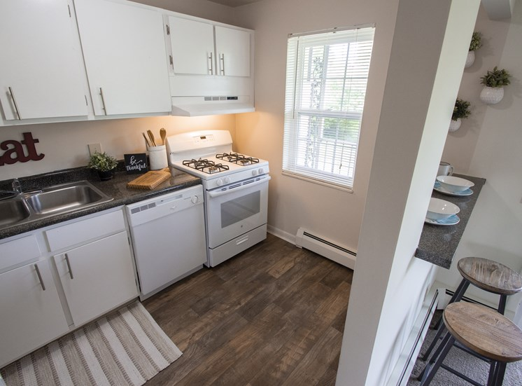 This is a photo of the kitchen in the 740 square foot 1 bedroom model apartment at Compton Lake Apartments in Mt. Healthy, OH.