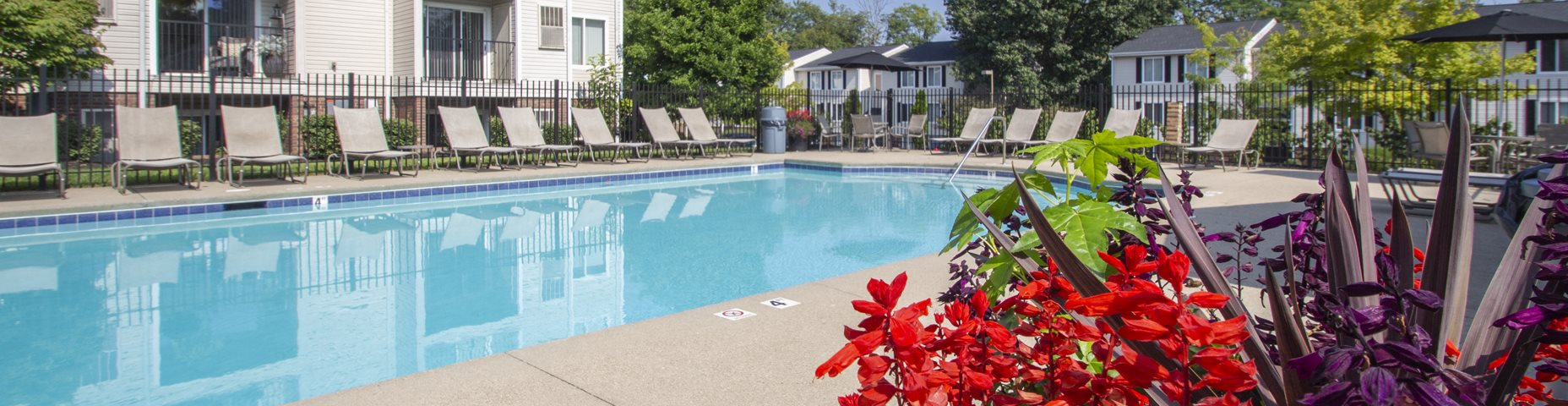 This is a picture of the pool area and apartment balconies at Deer Hill Apartments in Cincinnati Ohio.