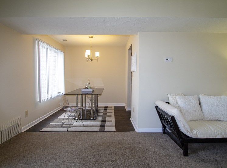 This is a photo of the dining room/living room in a 1 bedroom apartment at Deer Hill Apartments in Cincinnati, OH.