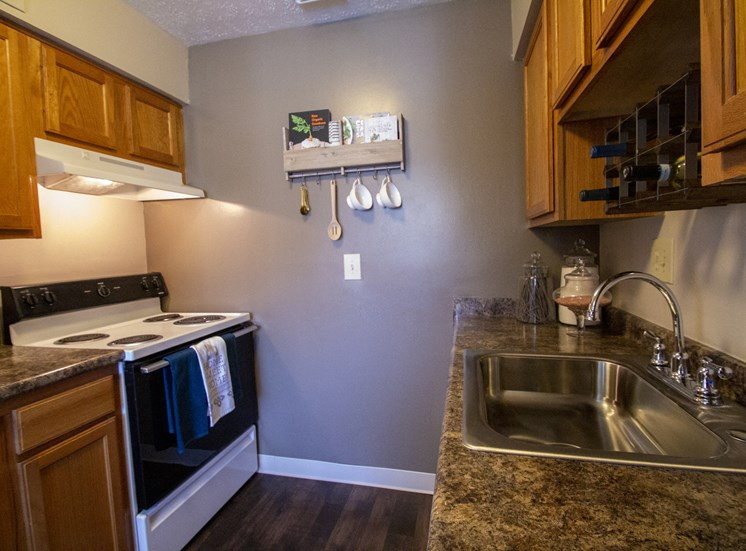 This is a photo of the kitchen in a 2 bedroom apartment at Deer Hill Apartments in Cincinnati, OH.