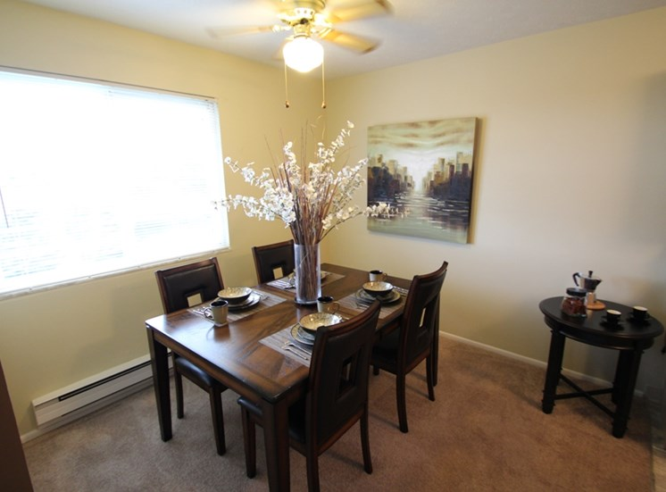 This is a picture of the dining room of the 850 square foot 1 bedroom apartment at Fairfield Pointe Apartments in Fairfield, Ohio