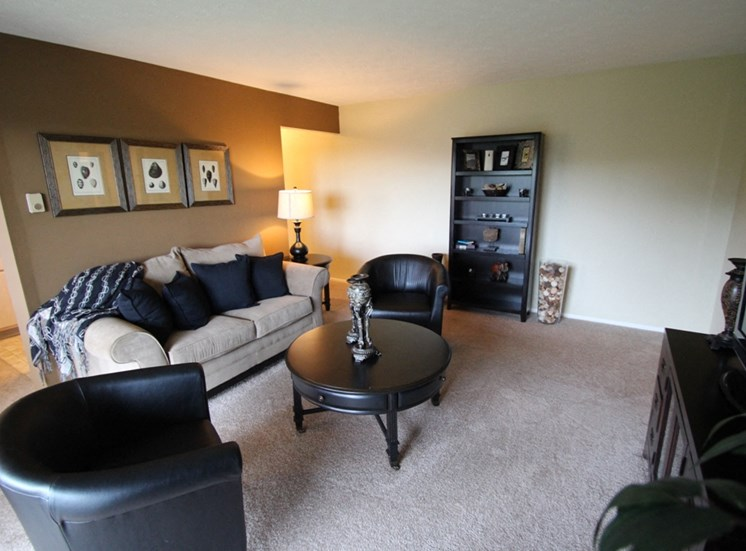 This is a picture of the living room of the 850 square foot 1 bedroom apartment at Fairfield Pointe Apartments in Fairfield, Ohio