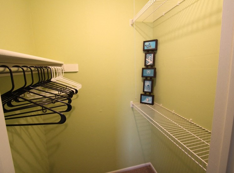 This is a picture of the bedroom walk-in closet of the 850 square foot 1 bedroom apartment at Fairfield Pointe Apartments in Fairfield, Ohio