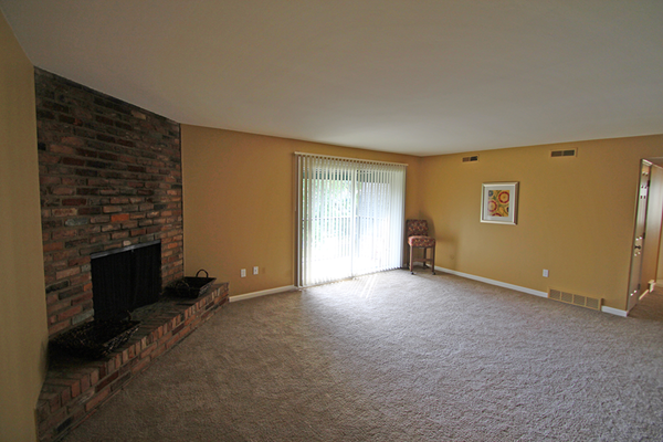 This is the exposed brick wall in the living room at Village East Apartments in Franklin, OH
