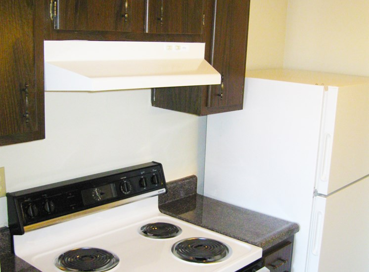 This is a photo of the kitchen in the 875 square foot 2 bedroom apartment at Wyoming Hills Apartments in Dayton, OH.