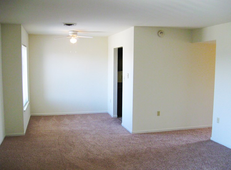 This is a photo of the living room/dining area in the 875 square foot 2 bedroom apartment at Wyoming Hills Apartments in Dayton, OH.