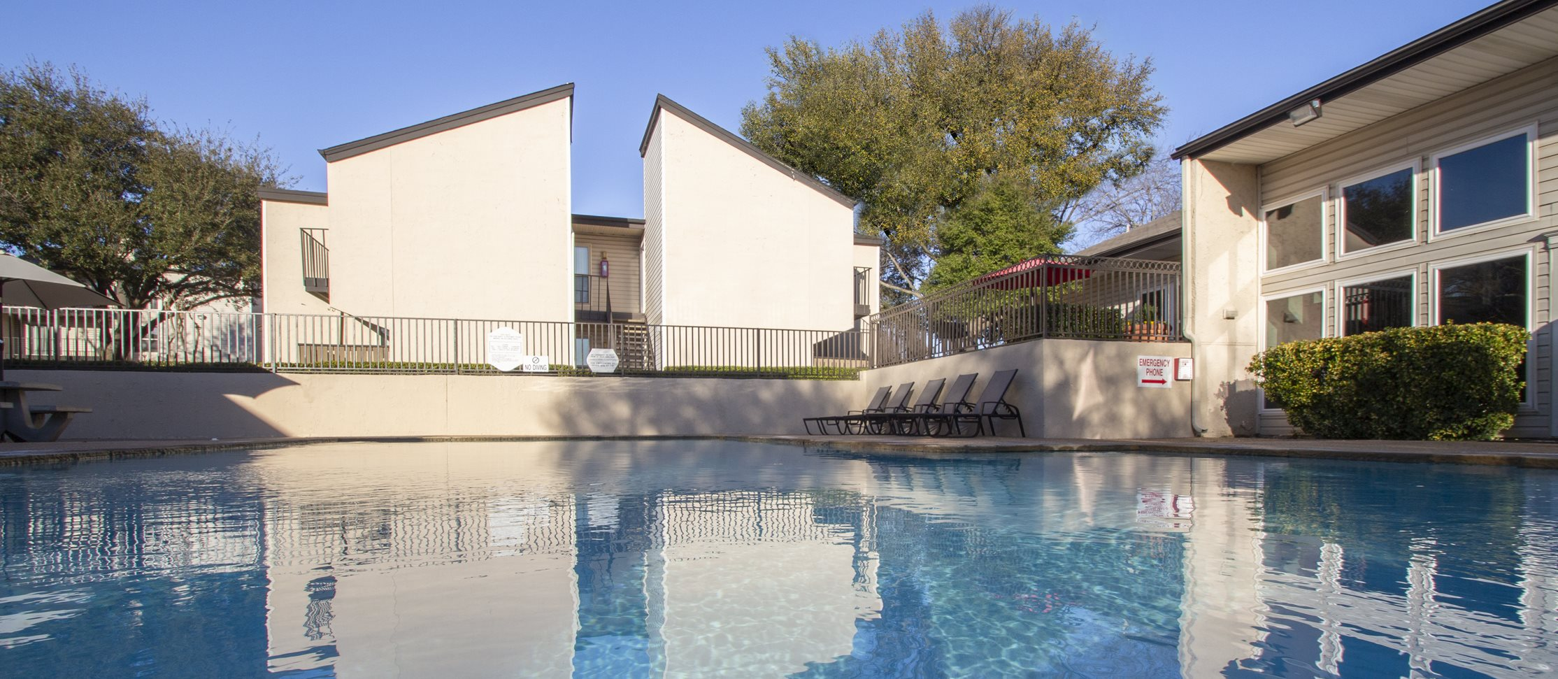 This is a photo of the pool area at The Biltmore Apartments in Dallas, TX