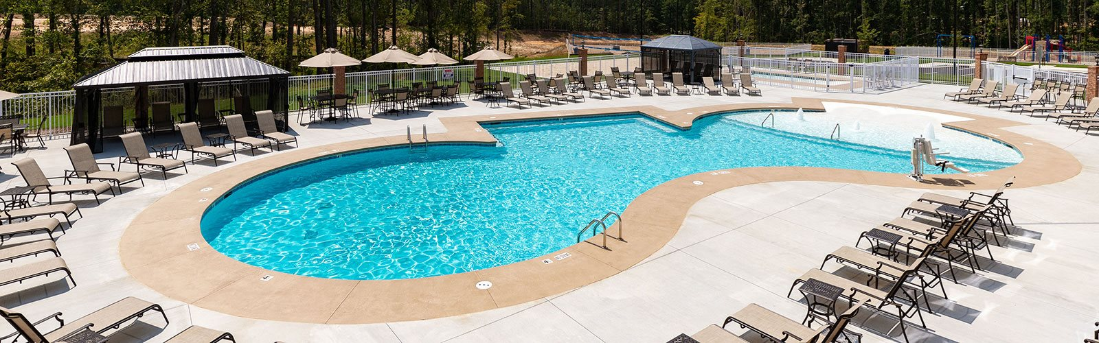 Outdoor zero-entry pool perfect for the warmer months at The Villages at Westford, Apex