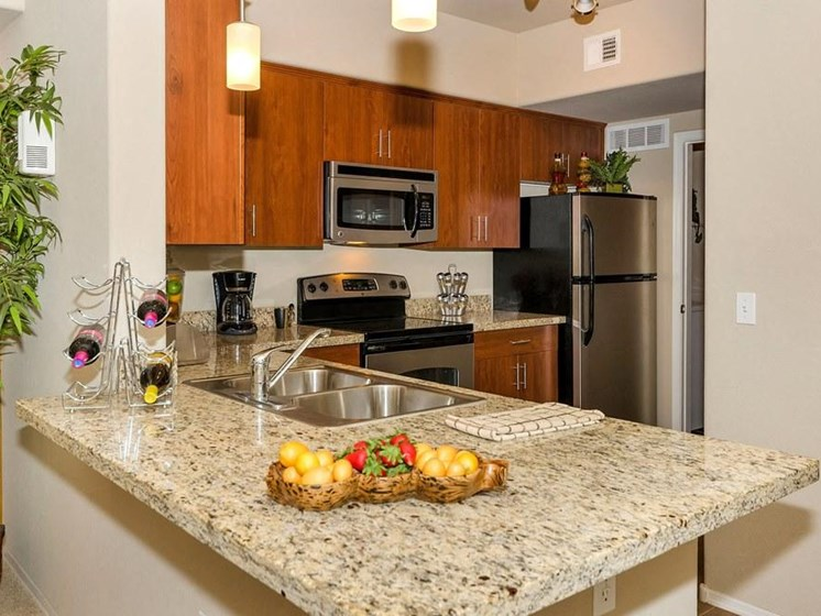 Model apartment home kitchen emphasizing countertops