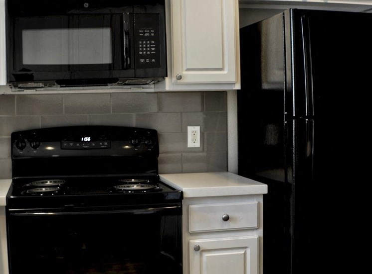 Vacant apartment home kitchen black appliances close up
