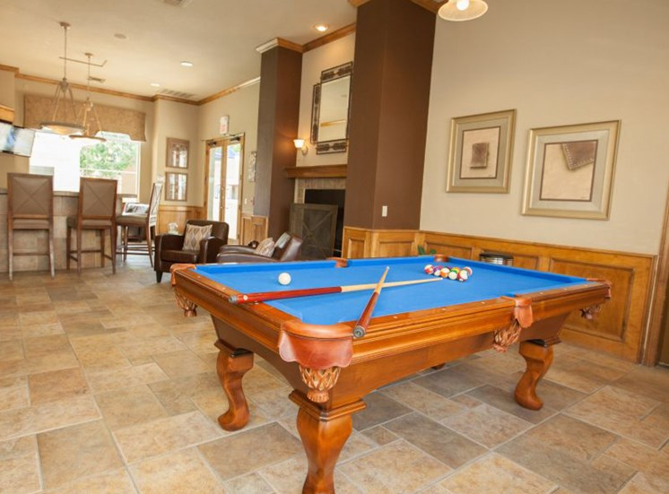 Resident clubhouse with kitchen, lounge seating, fireplace and billiard