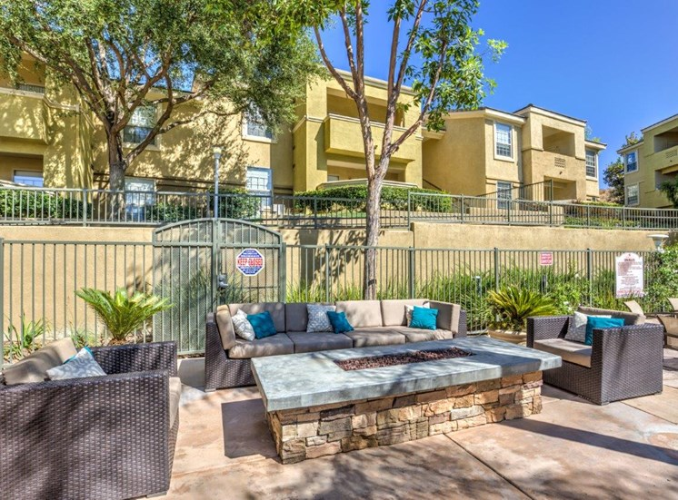 Apartments for Rent in Riverside, CA - Stone Canyon Apartments Outdoor Lounge with Firepit and Couches