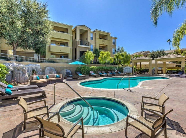 Apartments for Rent in Riverside - Stone Canyon Apartments Sparkling Pool with Hot Tub and Various Lounge Chairs