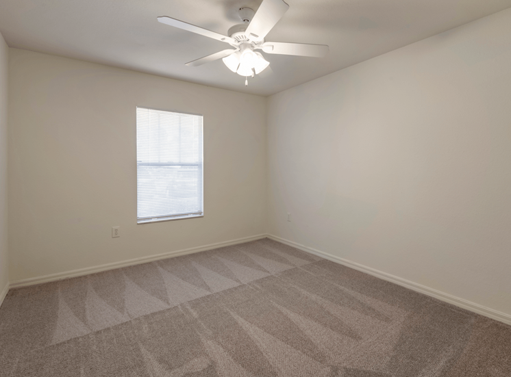 Carpeted Bedroom with Window and Ceiling Fan