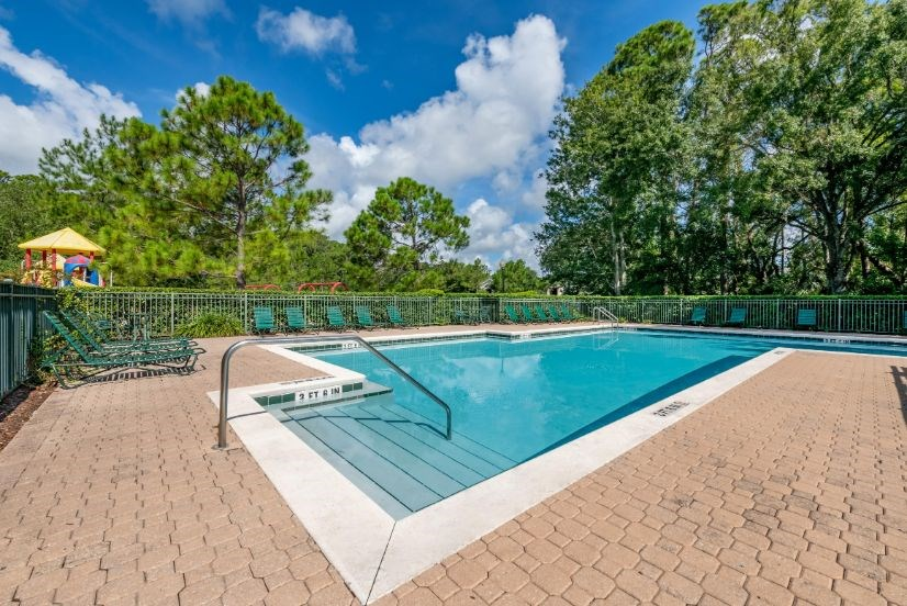 Whispering Woods | Lakeside Pool with Sundeck Seating