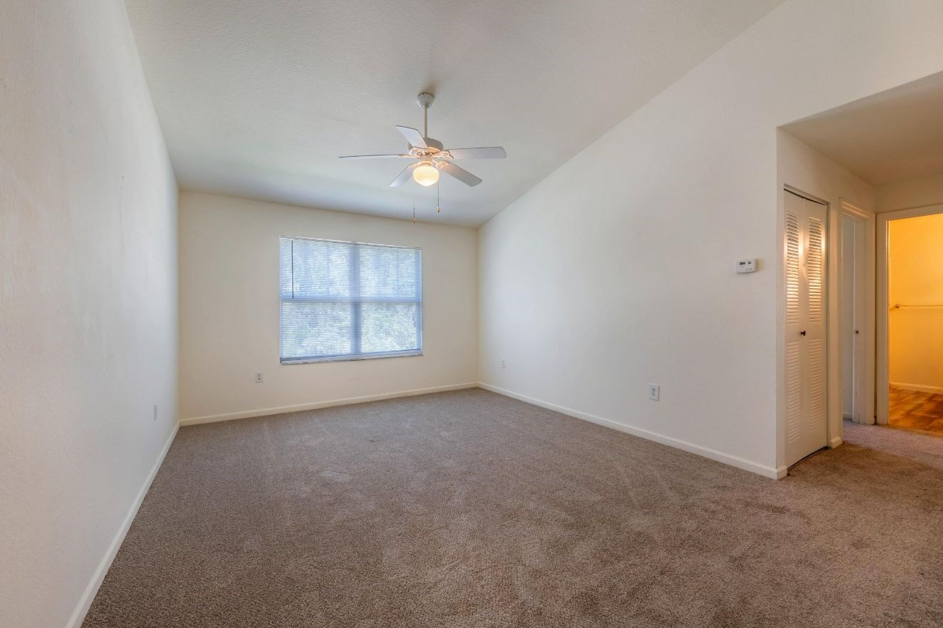 Whispering Woods | Living Room with Carpeted Flooring