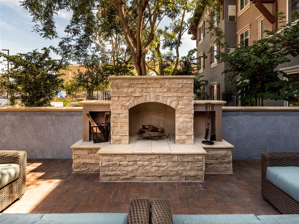 Brick Outdoor Fireplace with Lounge Seating  at Pacifica Senior Living Oxnard, California