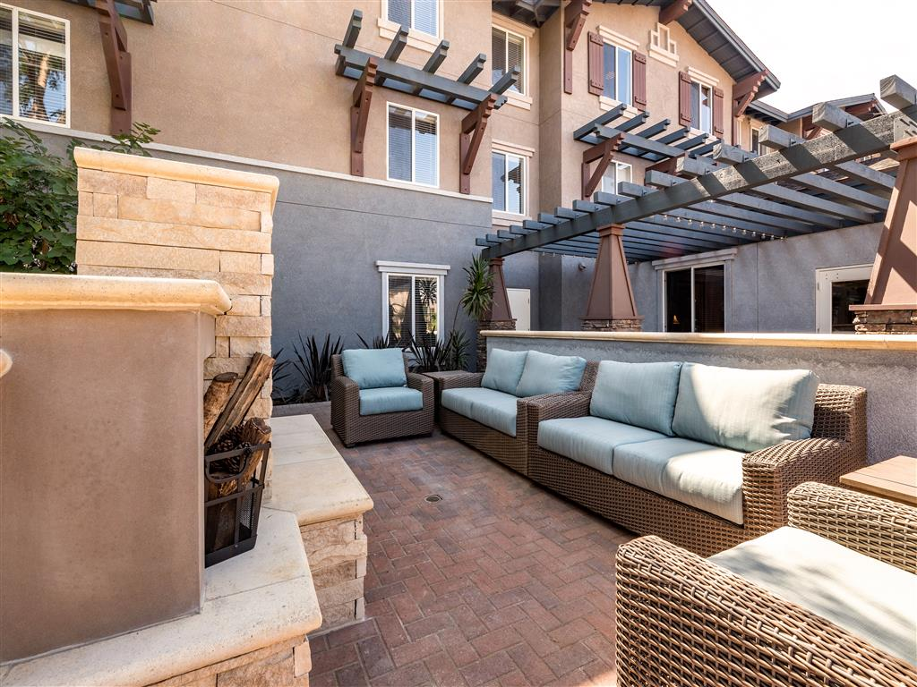Spacious Shaded Seating by Outdoor Fireplace at Pacifica Senior Living Oxnard, Oxnard, 93036