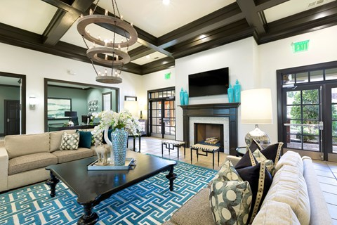 Community Lounge with chandelier and fire place