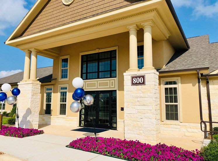 front entrance to apartment building with balloons in georgetown texas