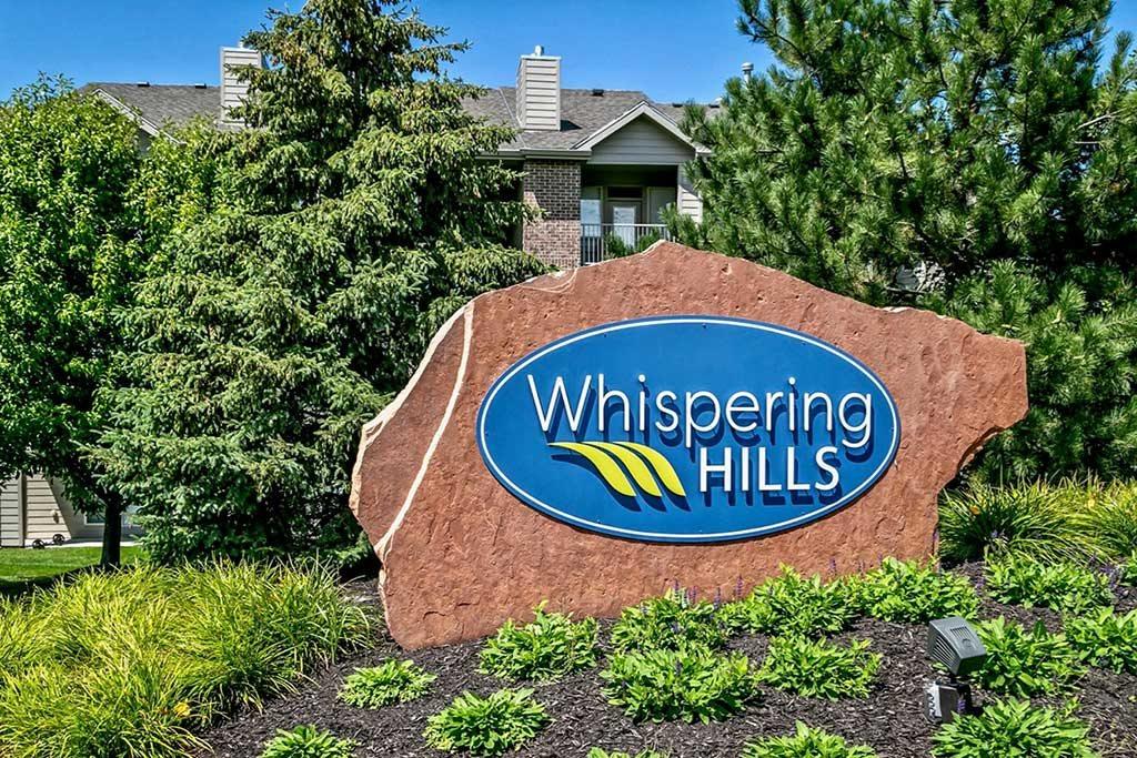 Property signage at Whispering Hills Apartments, Omaha NE