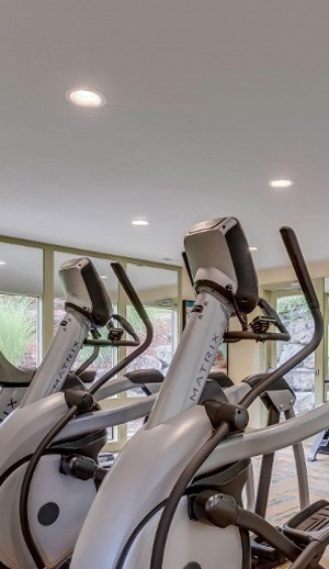 elliptical machine in gym at apartment building