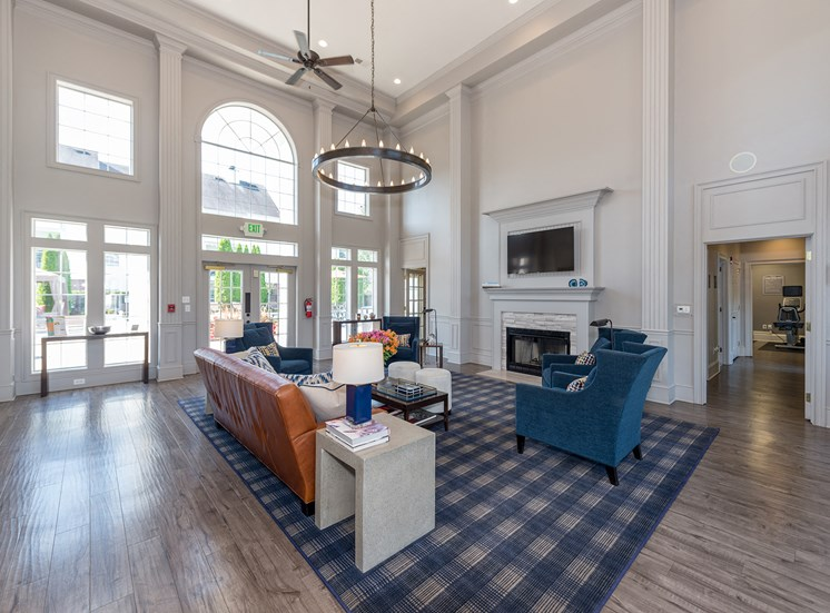 Swift Creek Commons Apartments - Resident clubhouse with fireplace