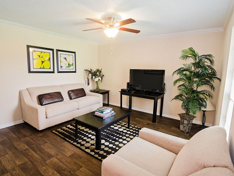 Living room with wood floor at 21 South at Parkview Apartments in Baton Rouge, LA
