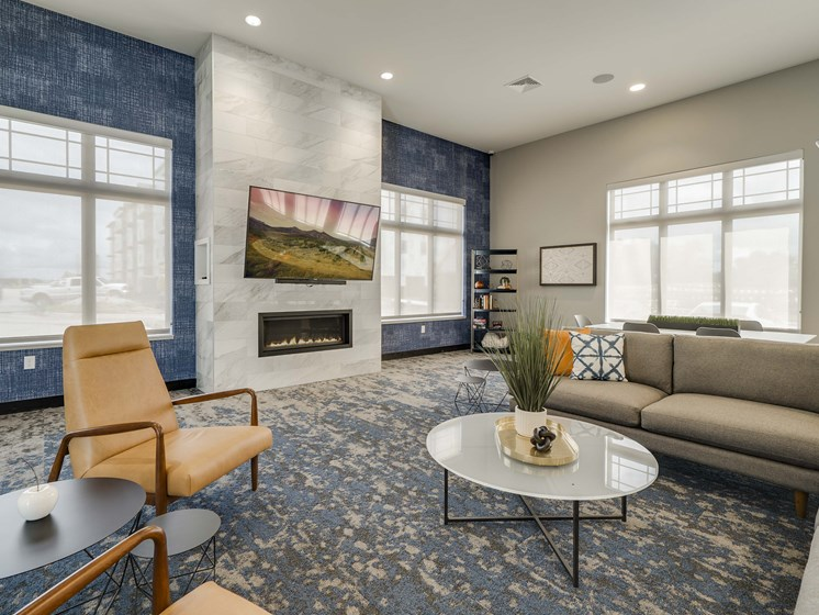 The beautiful clubhouse and fireplace at The Flats at Shadow Creek new luxury apartments in east Lincoln NE 68520