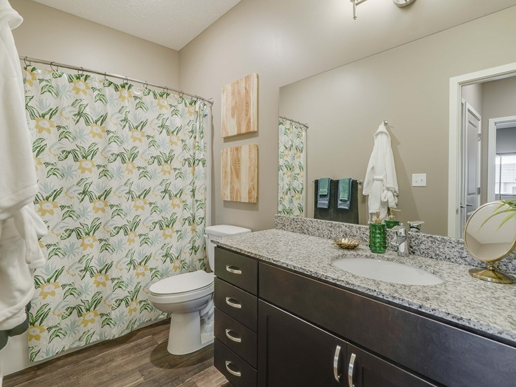 Large bathroom with granite countertop at The Flats at Shadow Creek new luxury apartments in east Lincoln NE 68520