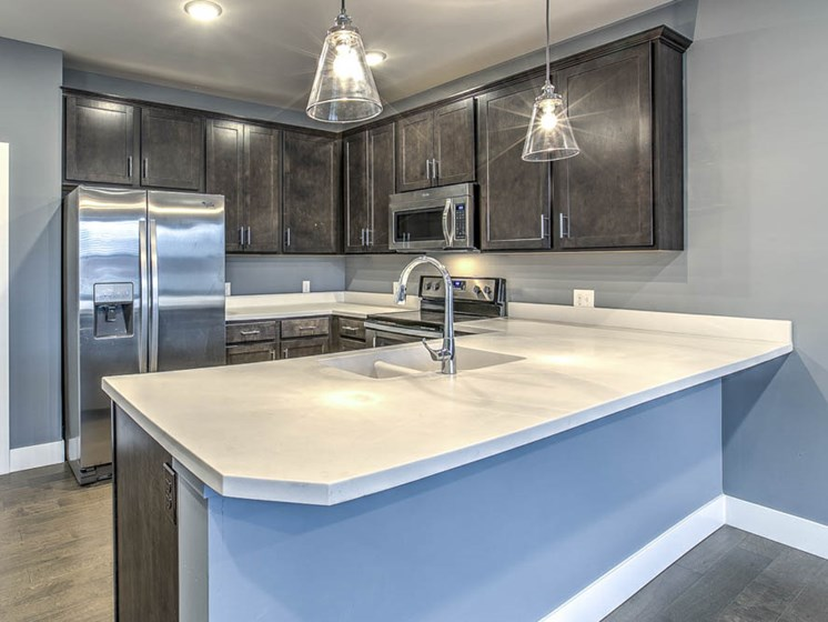 Updated kitchen with large counter top for breakfast bar seating at The Helen