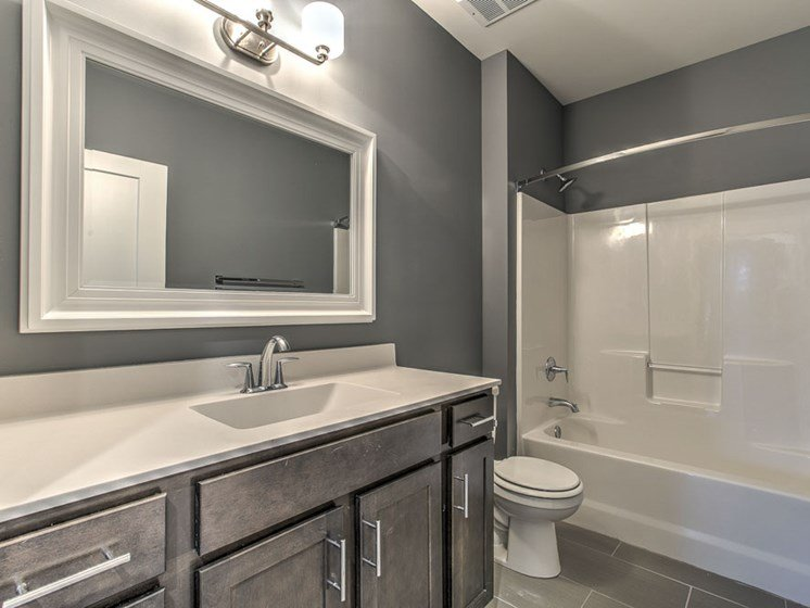 Bathroom with lots of counter space and a bathtub at The Helen