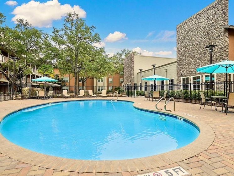 Swimming Pool Area with Shaded Chairs at NewForest Estates, Texas