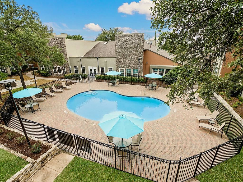 Heated Swimming Pool in Beautiful Area with Shaded Chairs at NewForest Estates, Texas