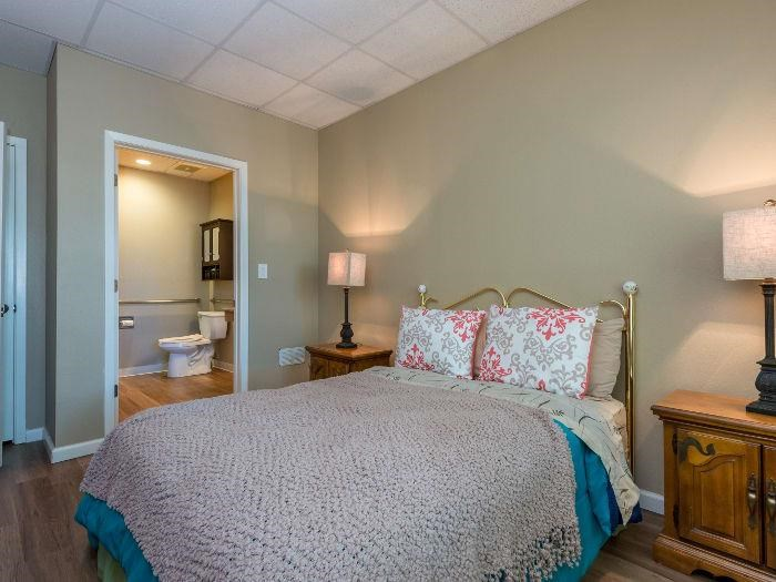 Bedroom and Bathroom at Pacifica Senior Living Santa Fe