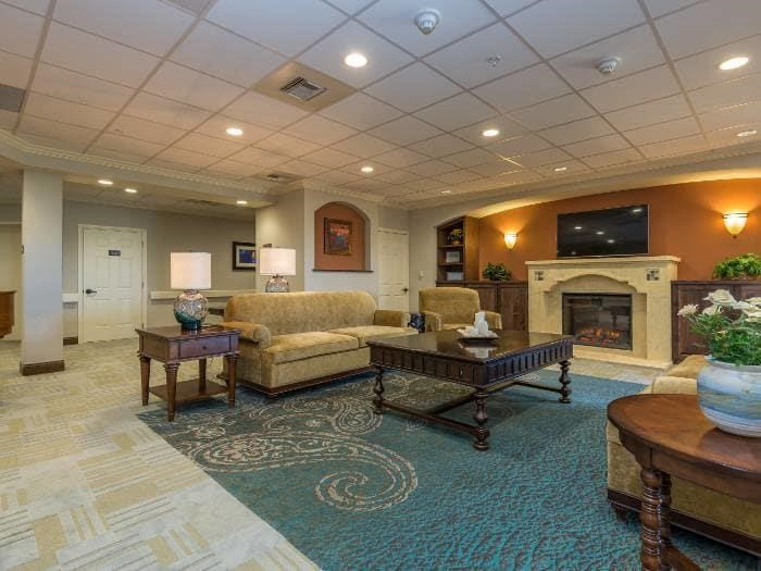 Gorgeous Living Room with a Fireplace at Pacifica Senior Living Santa Fe