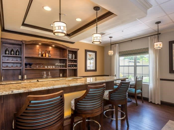 Kitchen bar with granite counter tops at Pacifica Senior Living Santa Fe in Santa Fe, NM