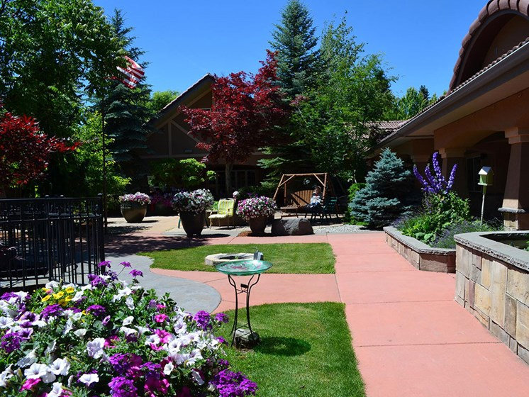 Courtyard With Flowers at Courtyard at Coeur d'Alene, Idaho, Pacifica Senior Living