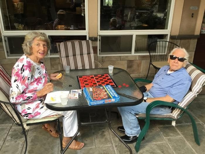 Senior living facility with patio games at Pacifica Senior LIving, the Courtyard at Coeur d'Alene, Idaho