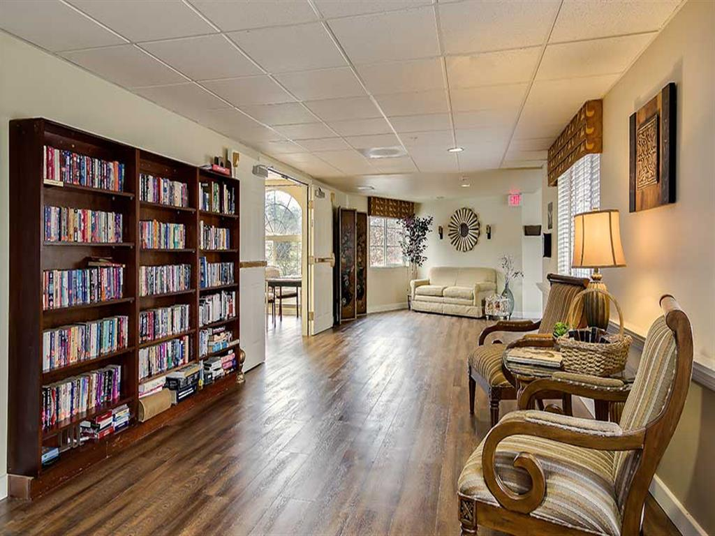 Relax in the library at Pacifica Senior Living Country Crest