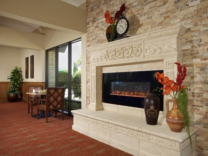 Gorgeous living room with a fireplace at Pacifica Senior Living Escondido