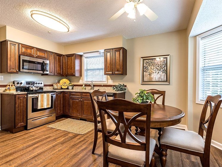 Kitchen and Dining in Model House at Pacifica Senior Living Heritage Hills in Hendersonville, North Carolina