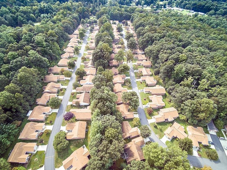 Breathtaking Aerial View of Forest Neighborhood at Pacifica Senior Living Heritage Hills in Hendersonville, North Carolina
