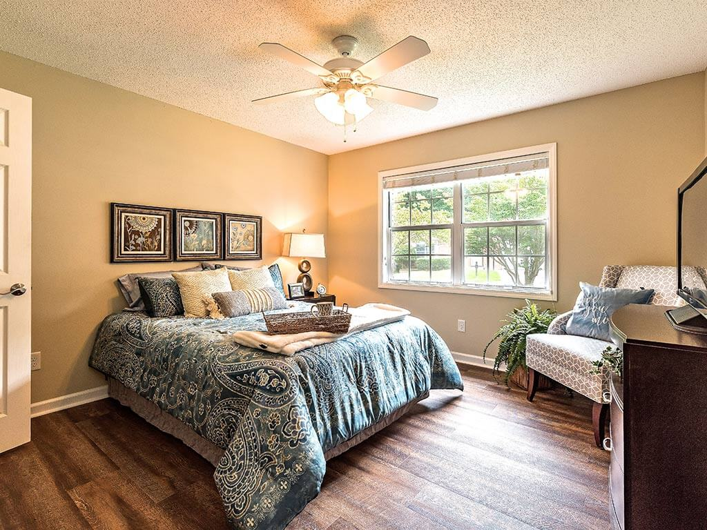 Bedroom Model House with Natural Light at Pacifica Senior Living Heritage Hills in Hendersonville, North Carolina
