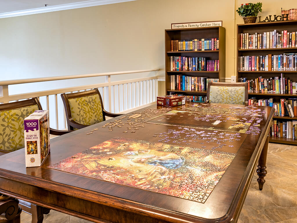 Large Table in Upstairs Library at Pacifica Senior Living Klamath Falls in Klamath Falls, Oregon