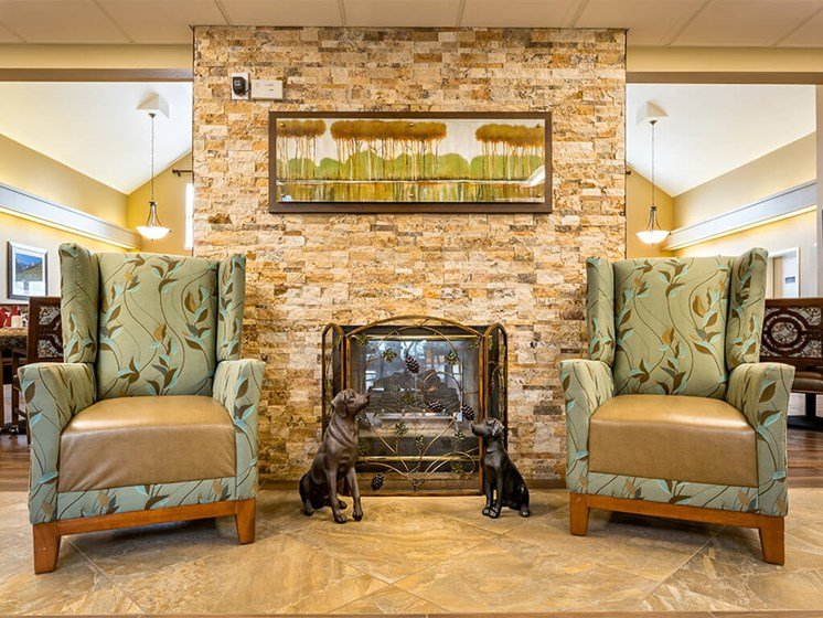 Sit with Friends Next to Fireplace at Pacifica Senior Living Klamath Falls, Klamath Falls, OR