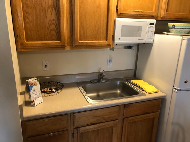 microwave in kitchen at Pacifica Senior Living Millcreek