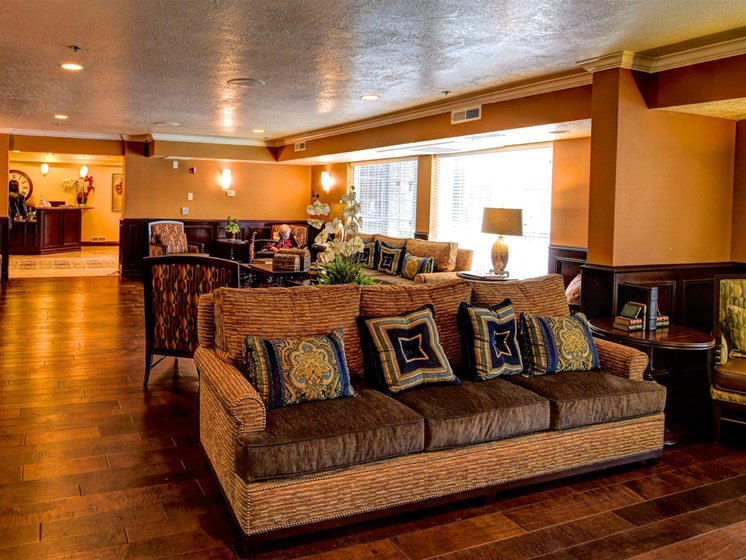 Comfy couch community area at Pacifica Senior Living Millcreek