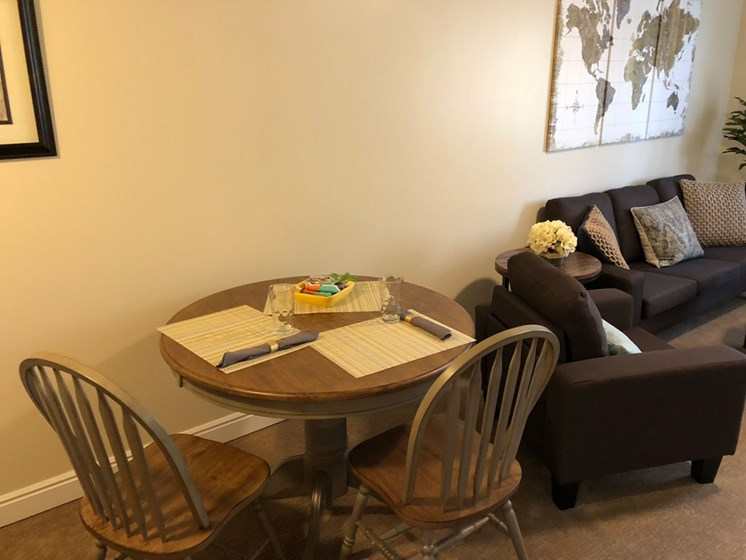 Living room and kitchen table at Pacifica Senior Living Millcreek in Salt Lake City, UT